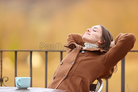 happy woman relaxing in a terrace