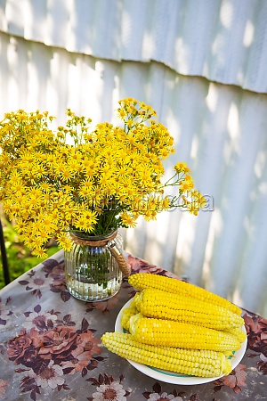 boiled corn lies on a plate