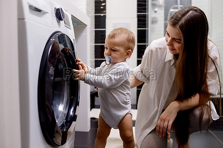 woman with infant child using washing