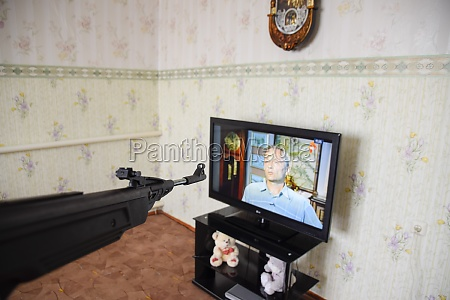 pneumatic gun aimed at the tv