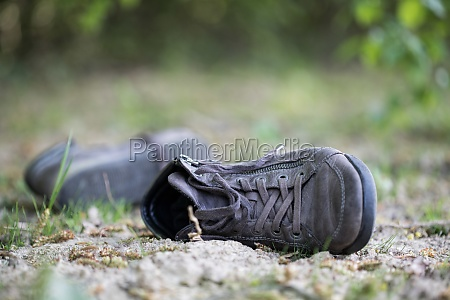 missing and poverty concept abandoned shoe
