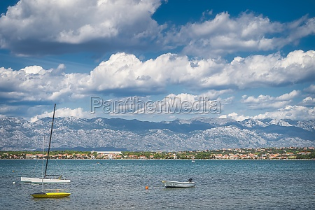 motorboats and sailboats anchored near adriatic