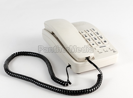 a white telephone with a black