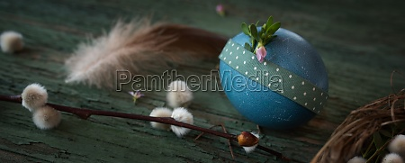 easter egg on old weathered wood