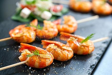 appetizing grilled prawns on skewer