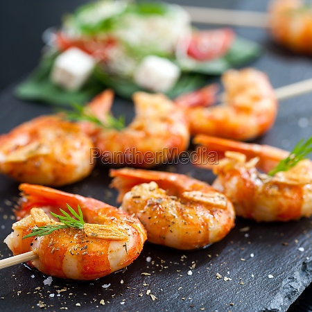 shrimp tails grilled on wood skewer