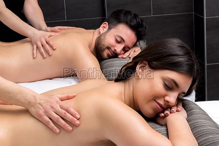 young couple enjoying body massage together