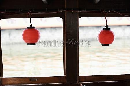 chinese lanterns hanging on a tourboat