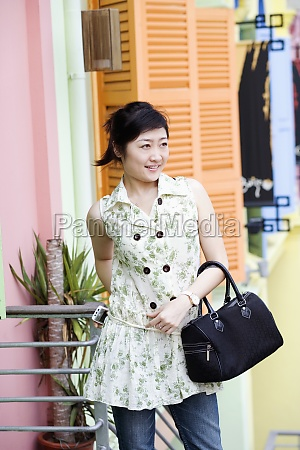 young woman holding a hand bag
