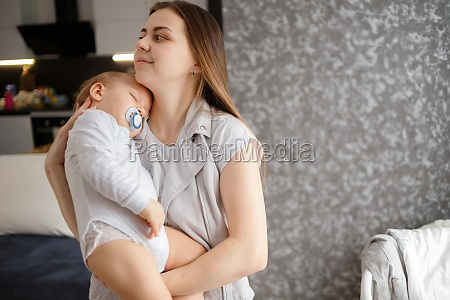 infant baby falled asleep in mother