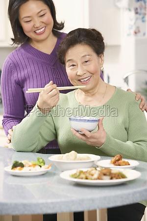 portrait of a senior woman eating