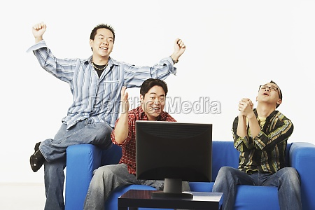three young men sitting on a