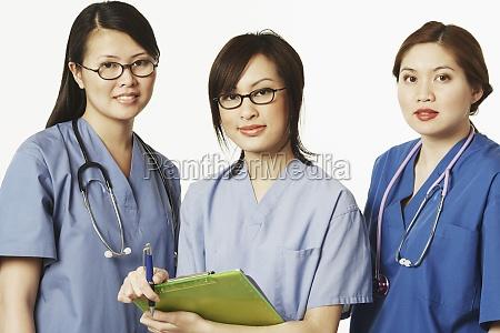 portrait of three female doctors standing