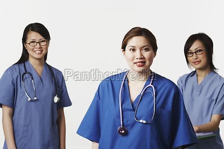 portrait of three female doctors smiling