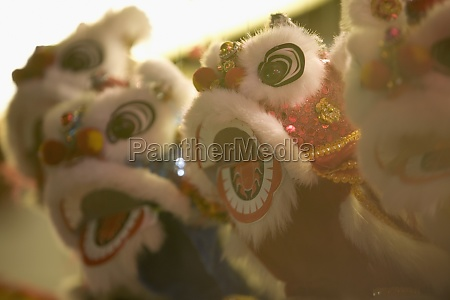 close up of chinese lion puppets