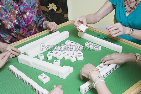 four women playing mahjong