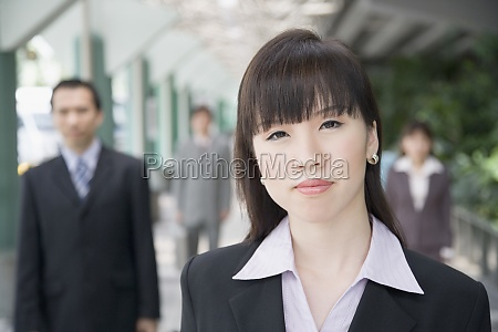 portrait of a businesswoman with three