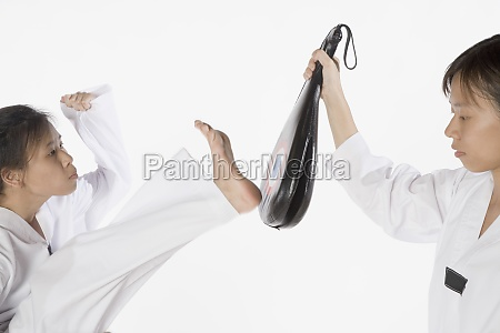 two young women practicing karate
