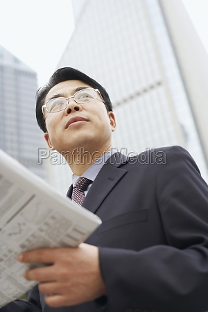 close up of a businessman holding