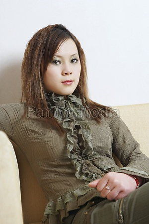 portrait of a young woman sitting