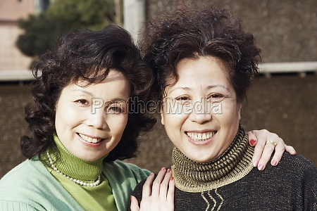 portrait of two mature women smiling