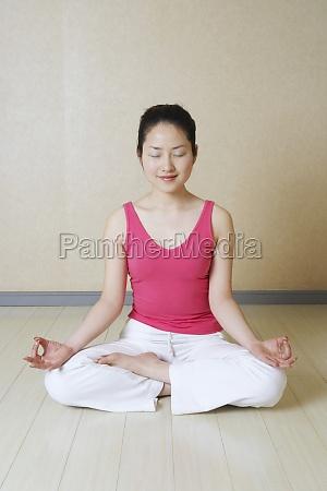 teenage girl meditating