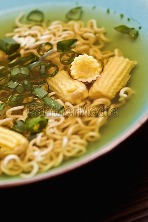 noodles and corns in a bowl