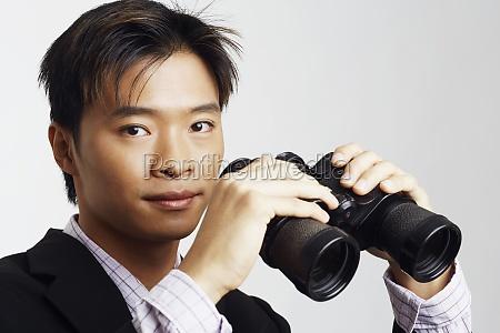 portrait of a businessman holding a