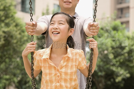 girl smiling on a swing with
