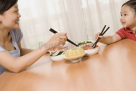mid adult woman having food with