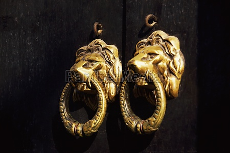 close up of two door knockers