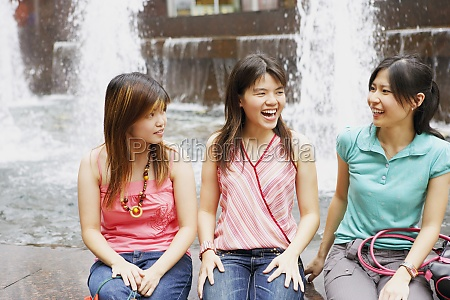 three young women sitting together at