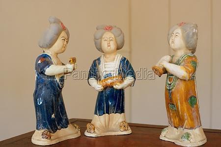 close up of three figurines on