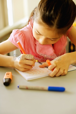 close up of a girl writing