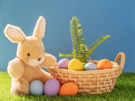 bunny toy and easter eggs in