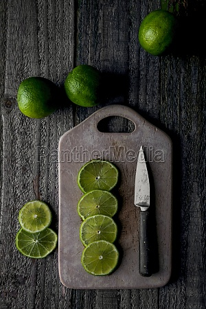 limes cut on a wooden board