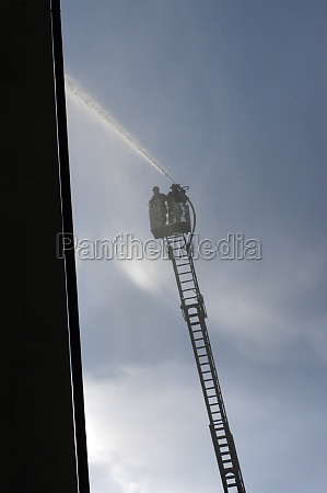 fire fighters on a fire ladder