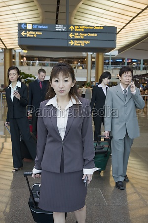 business executives leaving an airport