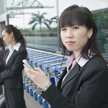 two businesswomen waiting at an airport