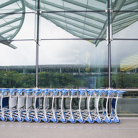 luggage carts in a row outside