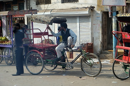 cycle rickshaw drivers waiting for clients