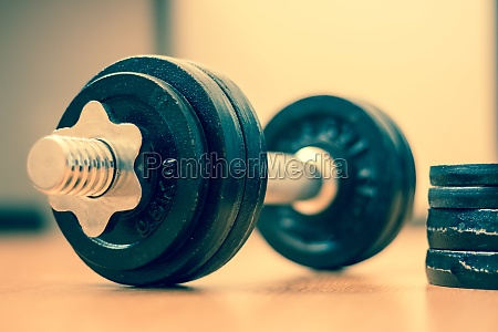 bodybuilding concept barbell and weights on