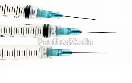 studio shot of syringes with needles