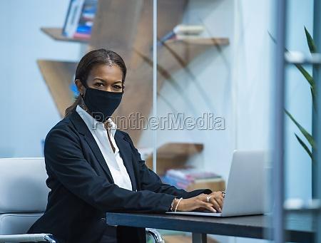 portrait of businesswoman wearing face mask