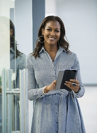 portrait of smiling businesswoman with digital