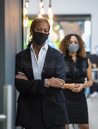portrait of businesswomen in face masks