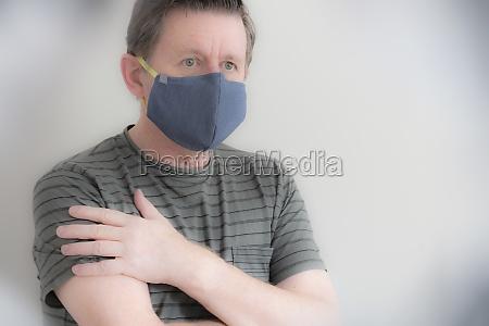 mature man wearing protective face mask