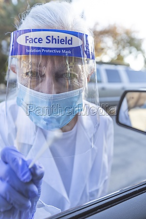 female medical staff in protective clothing