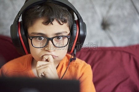 boy 8 9 gaming on tablet