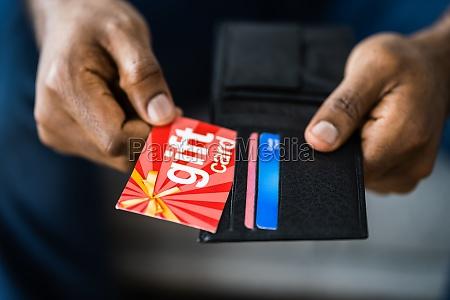 african hand holding gift card voucher